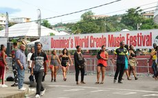 People leave the Windsor Park Sports Stadium, the site of the World Creole Music Festival